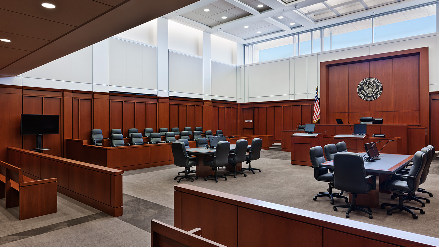Placing the judges' chambers on a mezzanine narrowed the building cross section and allowed for more natural daylight throughout the office floors and courtrooms.