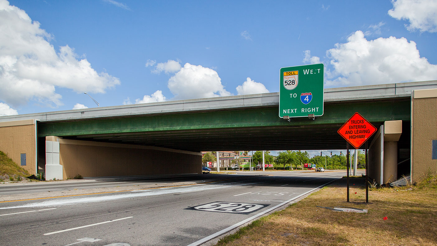 We widened the existing SR 528 bridge over Conway Road to accommodate the new plaza, and a new bridge was constructed over Daetwyler Drive.