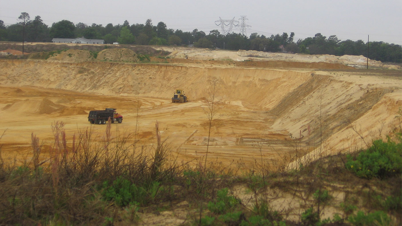 Among the many obstacles along the eight miles of land were two 40-foot deep active borrow pits, which were detailed using laser scanning – a surveying process that took less than two days.