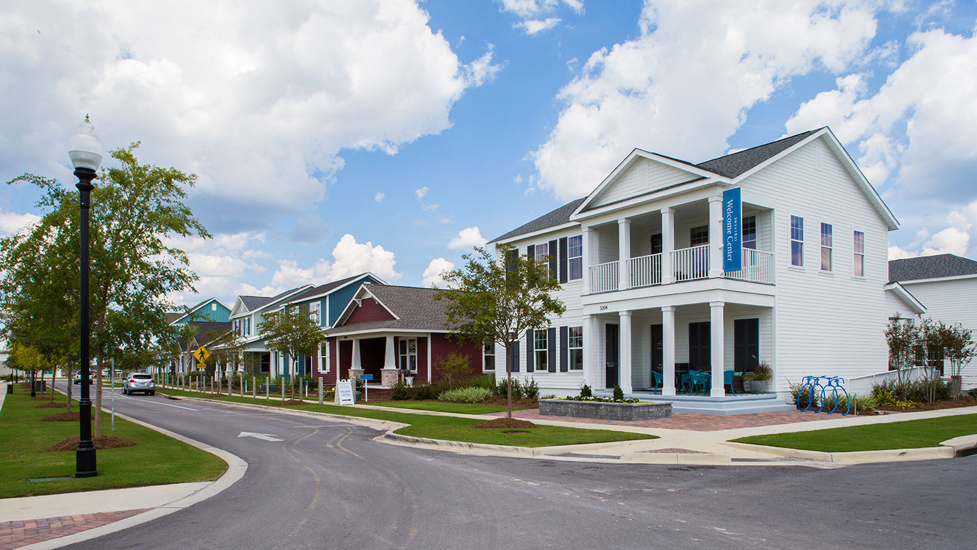 The community is designed around four pillars: walkability, preservation of the bay front, honoring local history and traditions, and promoting wellness through outdoor living.