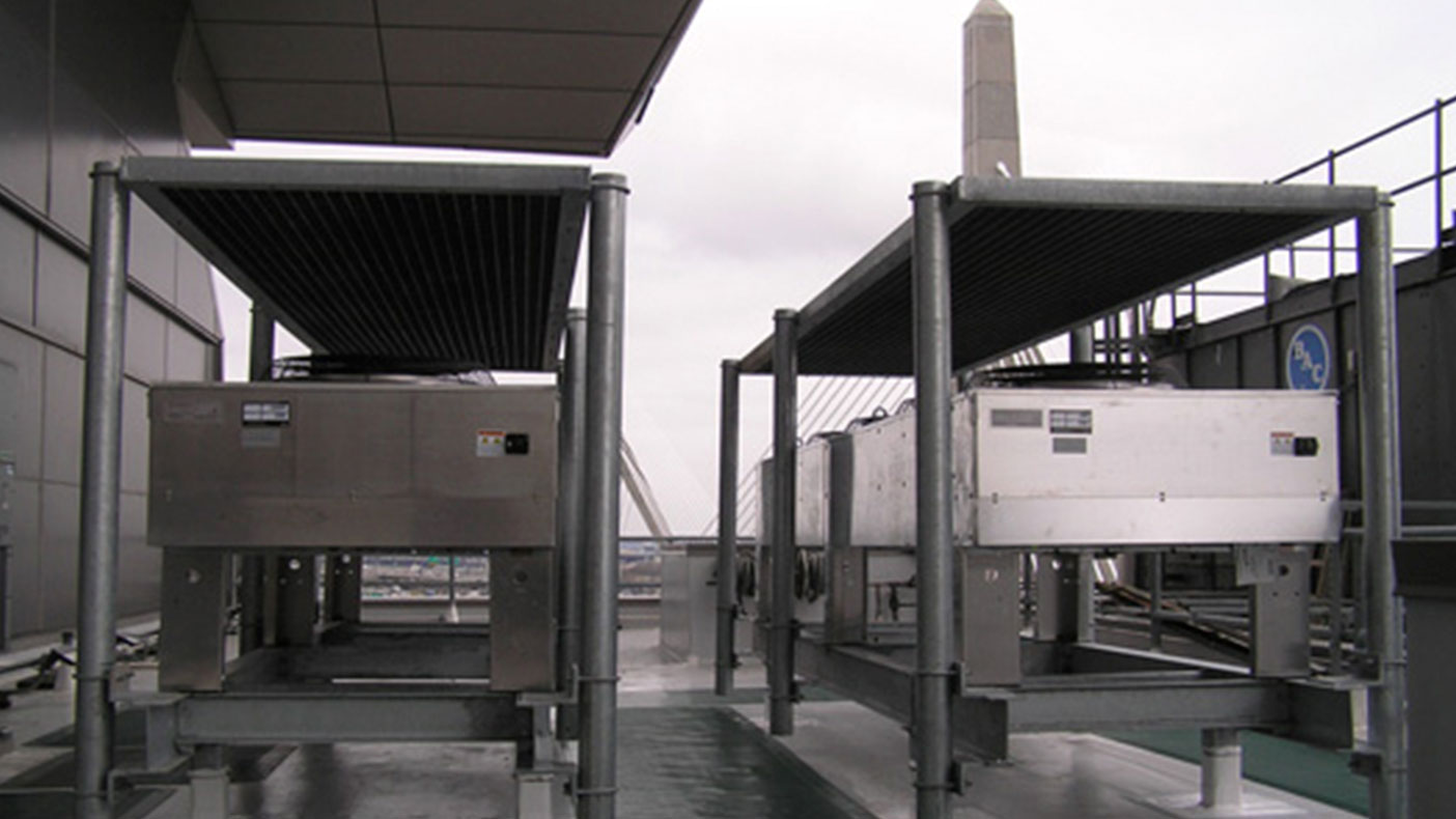Two 30-ton split system A/C units were installed with the condensers located on custom steel frames on the roof of the building.