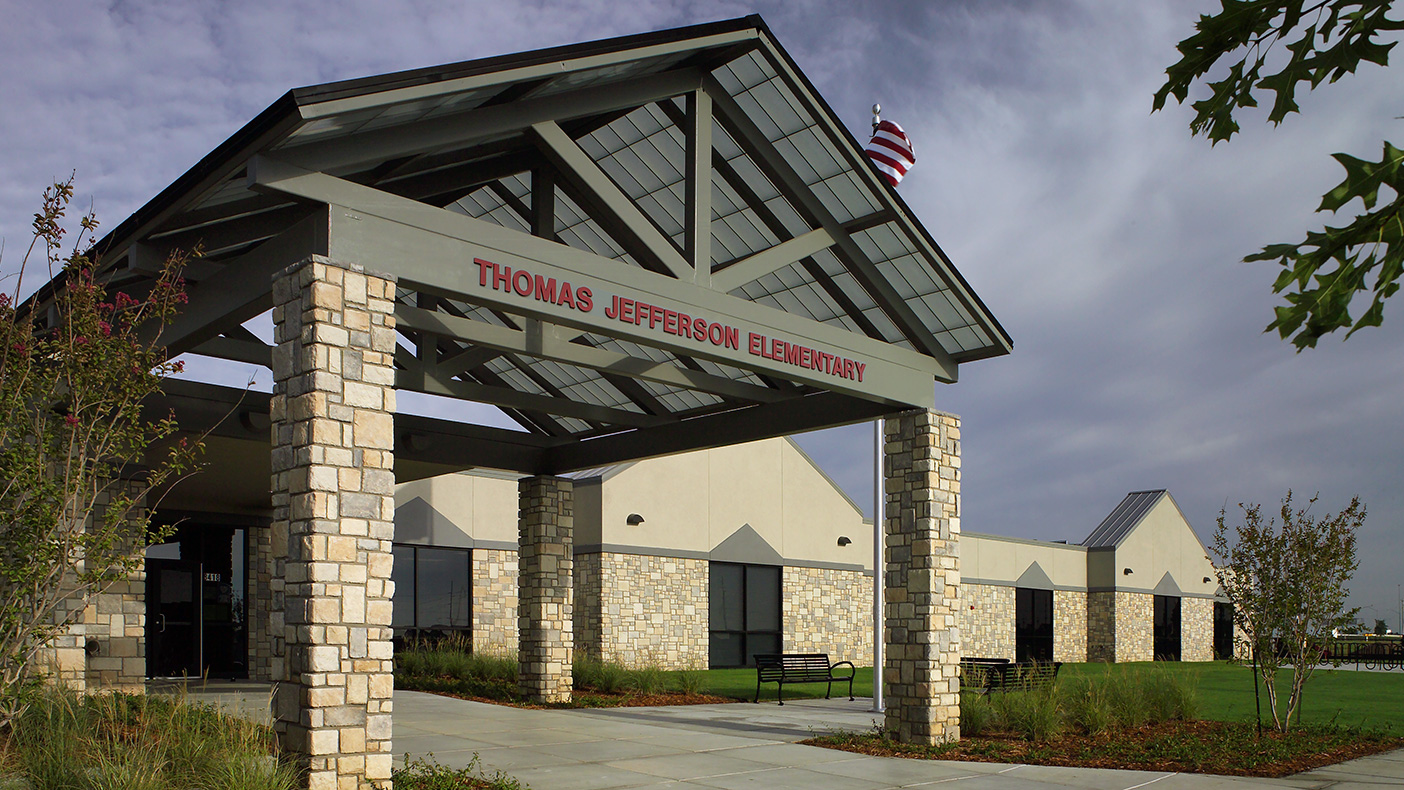 Natural stone highlights the façade of the 69,356 SF school.