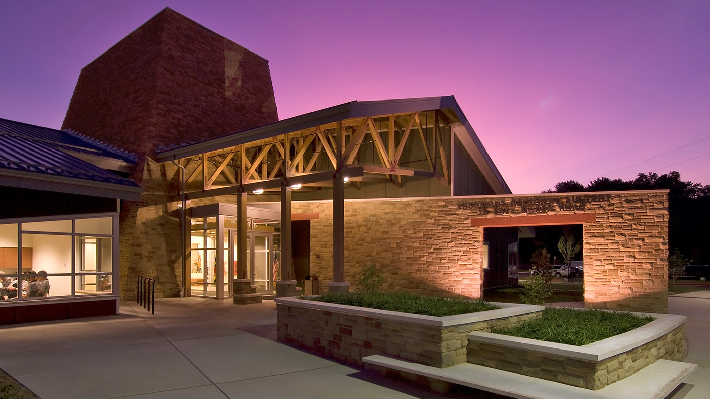 The soaring stone tower forming the library entrance and 40-foot-high centerpiece lobby also serves as exhibition space, used for library functions and community events often held after library hours.