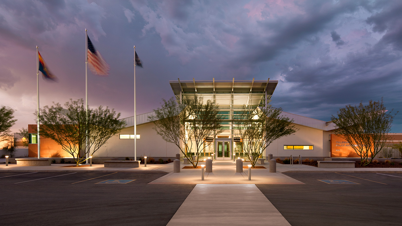 The double butterfly roof, separated by one central light-filled entrance, serves both police and municipal court departments' entrances in this dual-use facility.