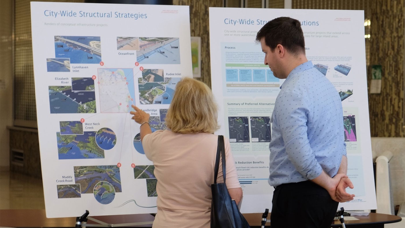 Connor Rutten discussing with a resident the structural flood defense options our team developed for locations across the city.
