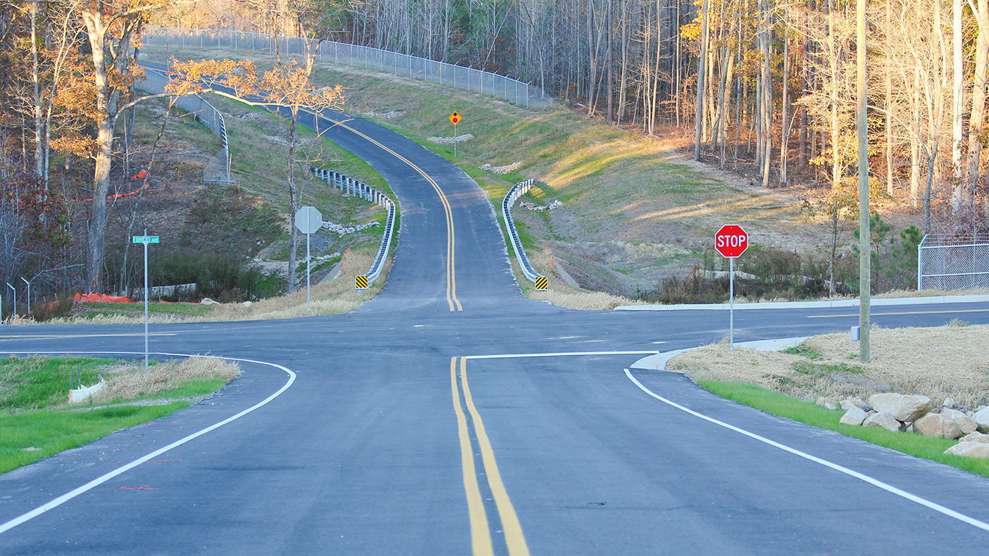 New training tracks feature a variety of road configurations: a cloverleaf ramp, city intersections, interstate acceleration lanes, a roundabout, railroad tracks, 25,000-square-foot skidpan, cul-de-sacs, and 342,000-SF precision-driving course.