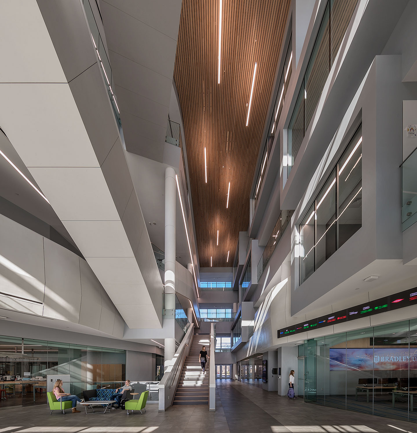 Designed using a modern interpretation of collegiate gothic architecture, the 390,000-SF facility includes more than 60 classrooms, three auditoriums, social space for students and faculty, breakout rooms, conference space, and a café.