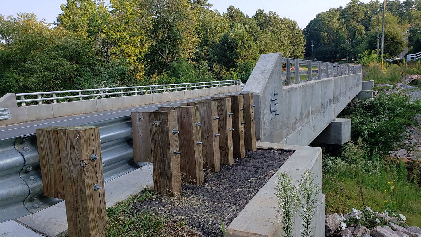 We were hired by the city of Raleigh to complete the planning, survey, roadway design, structure design, permitting, and construction administration for the Lake Dam Road Bridge replacement.