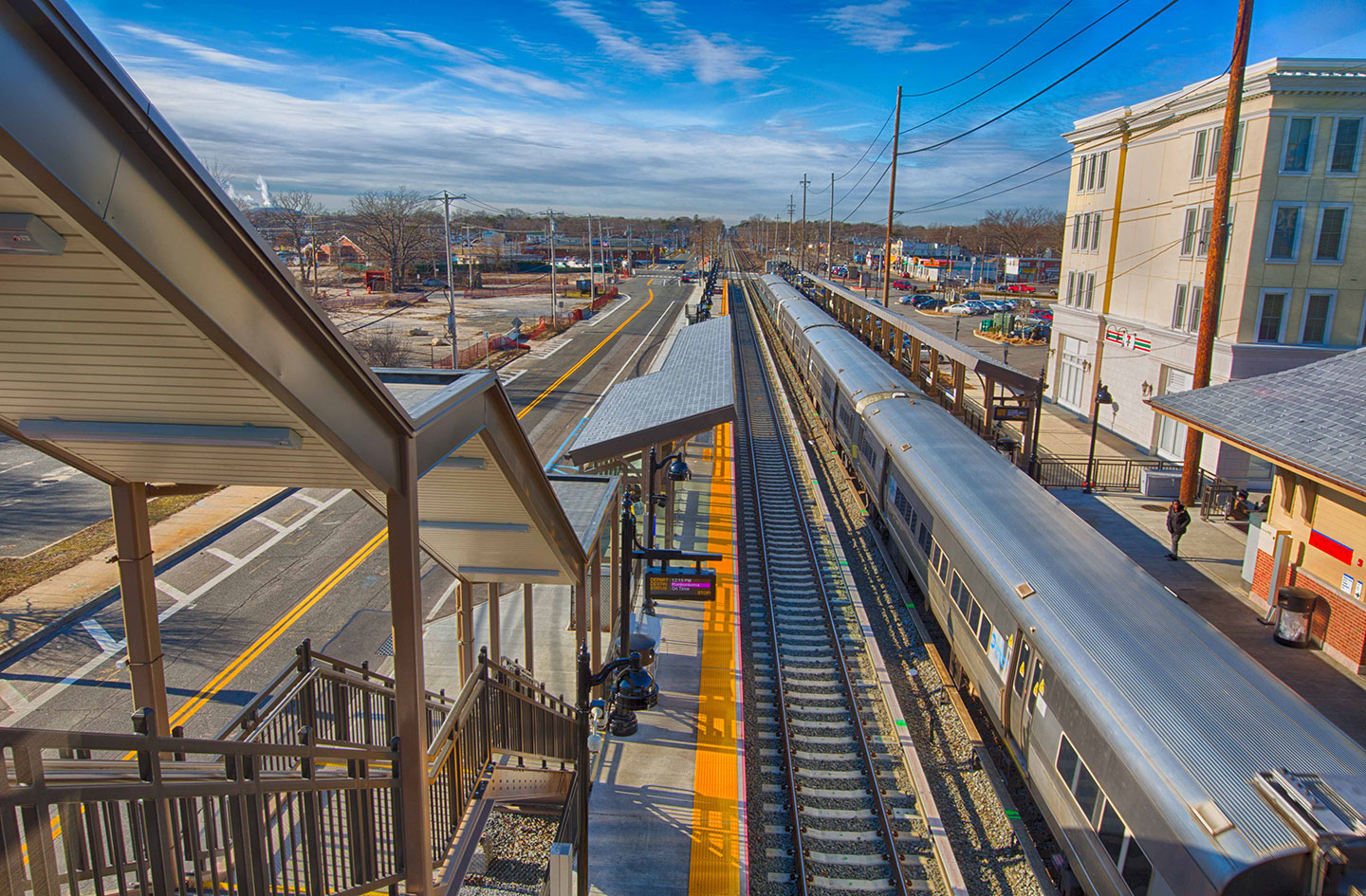 Station improvements included a pedestrian overpass with ADA-compliant elevators, new stairs, new canopies, and new platform shelters.